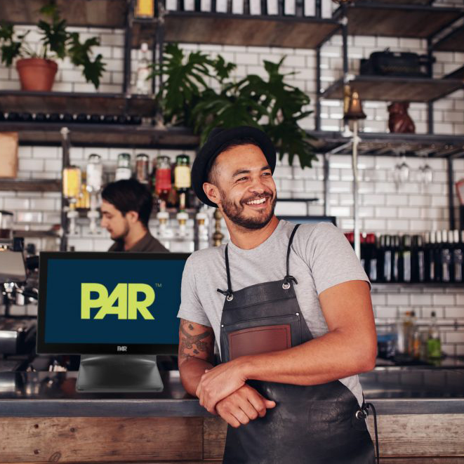 Barista in front of a PAR terminal